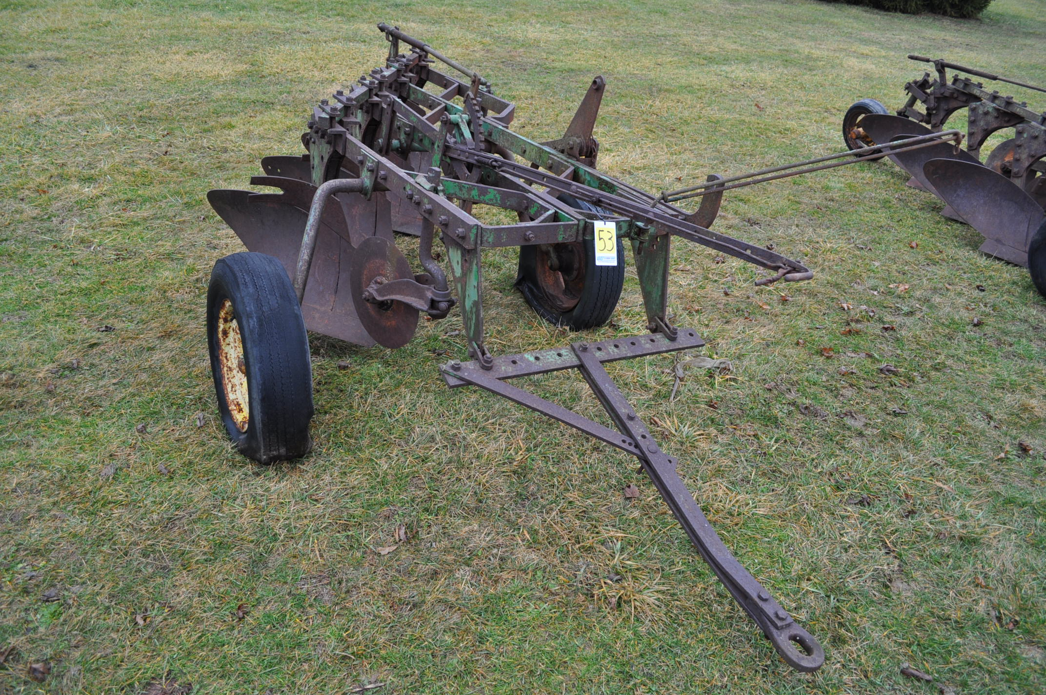 "John Deere 4 x 16"" plow, pull-type"