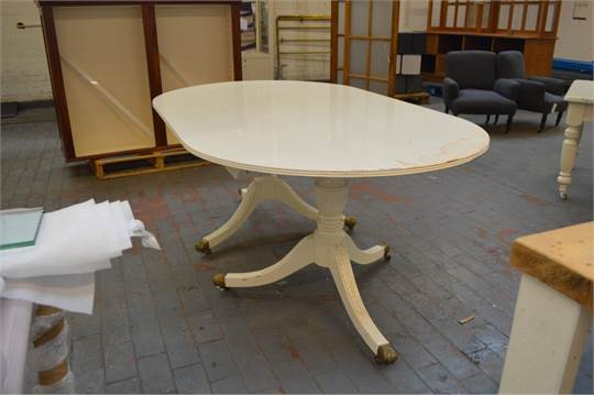 A White Painted Regency Style Twin Pedestal Dining Table Raised On Carved  Fluted Outswept Support