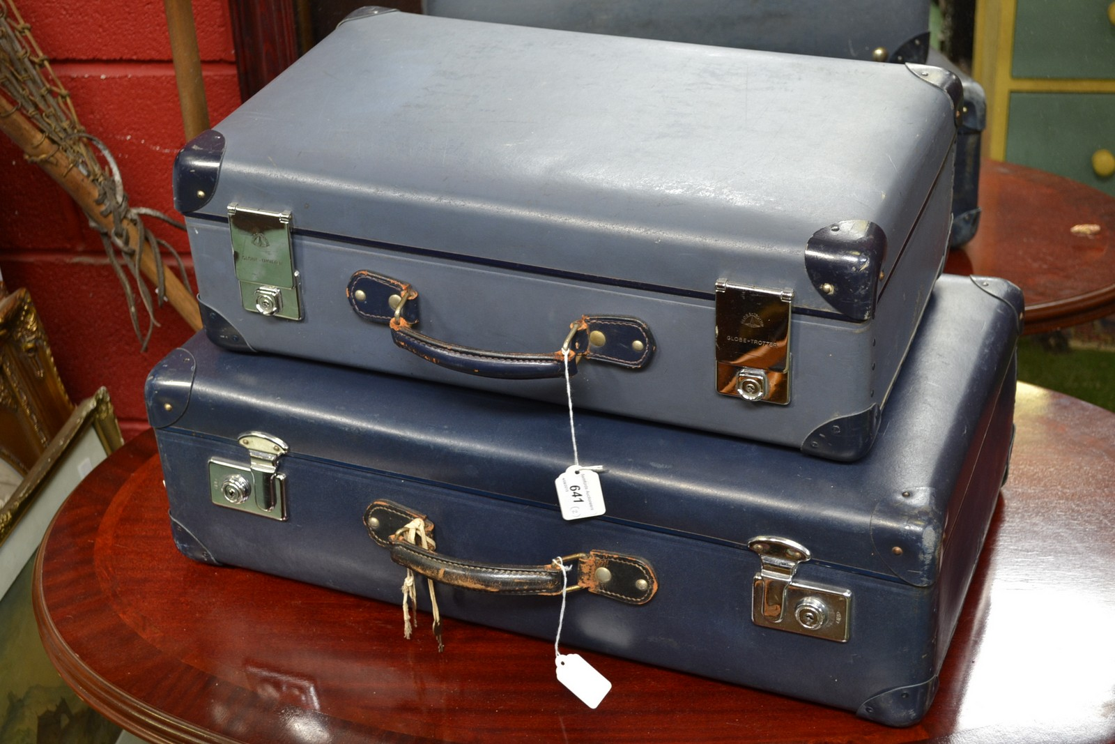 A vintage Globetrotter suitcase in blue, with keys; another ...