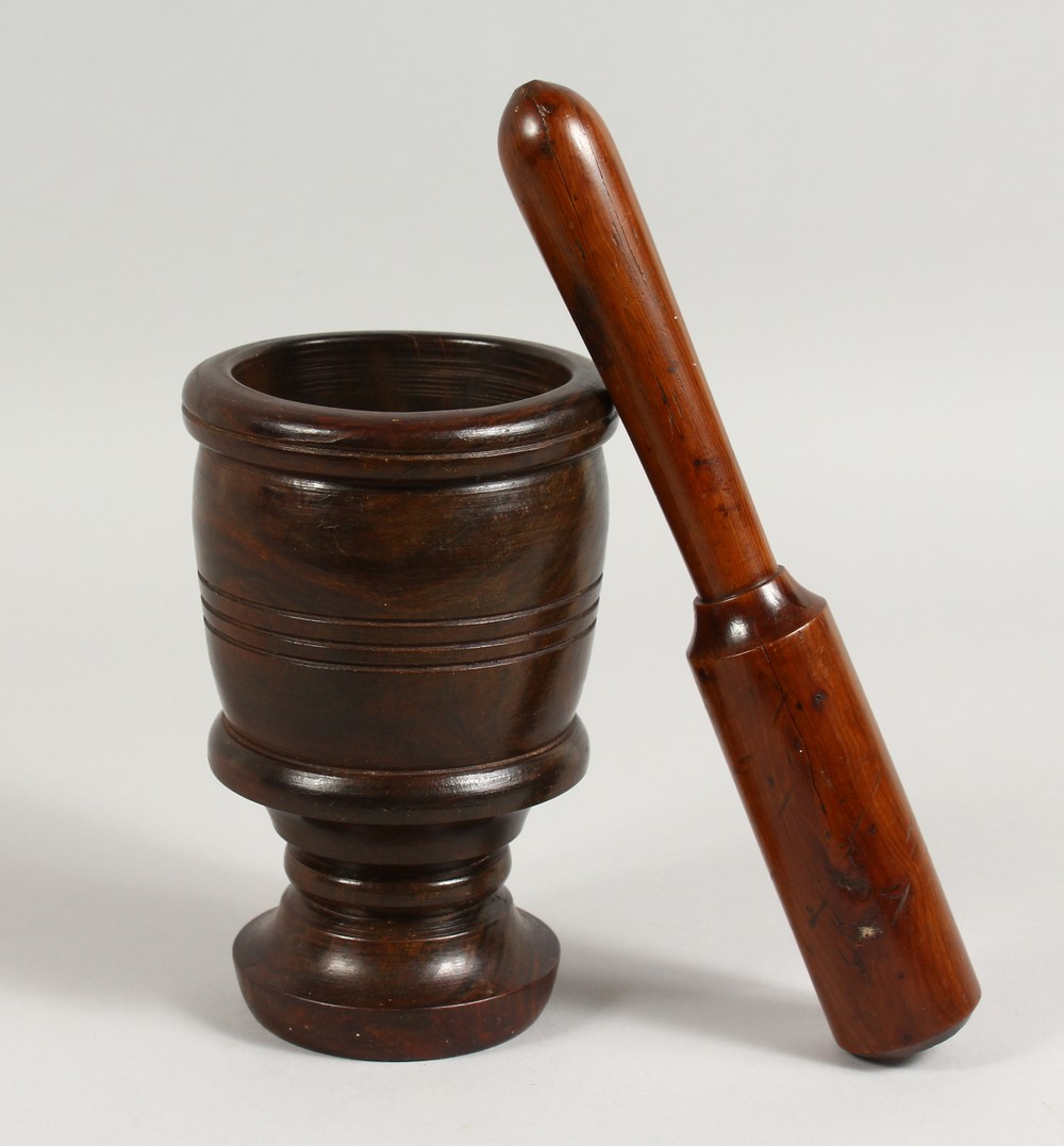 Lot 1512 - A 19TH CENTURY YEW WOOD PESTLE AND LIGNUM VITAE MORTAR. Mortar: 7ins high.