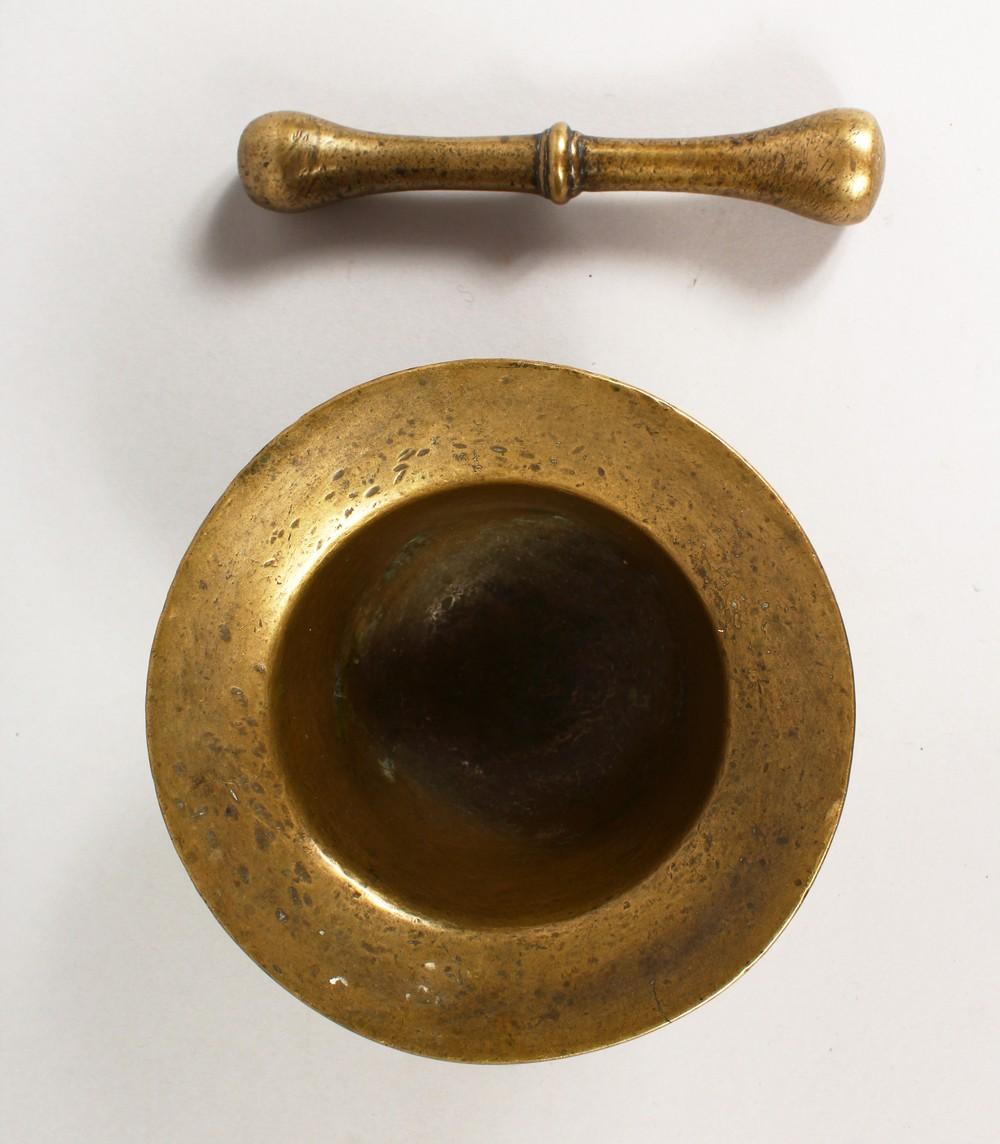 Lot 1410 - A 16TH/17TH CENTURY CAST BRONZE PESTLE AND MORTAR. Mortar: 5.5ins diameter.