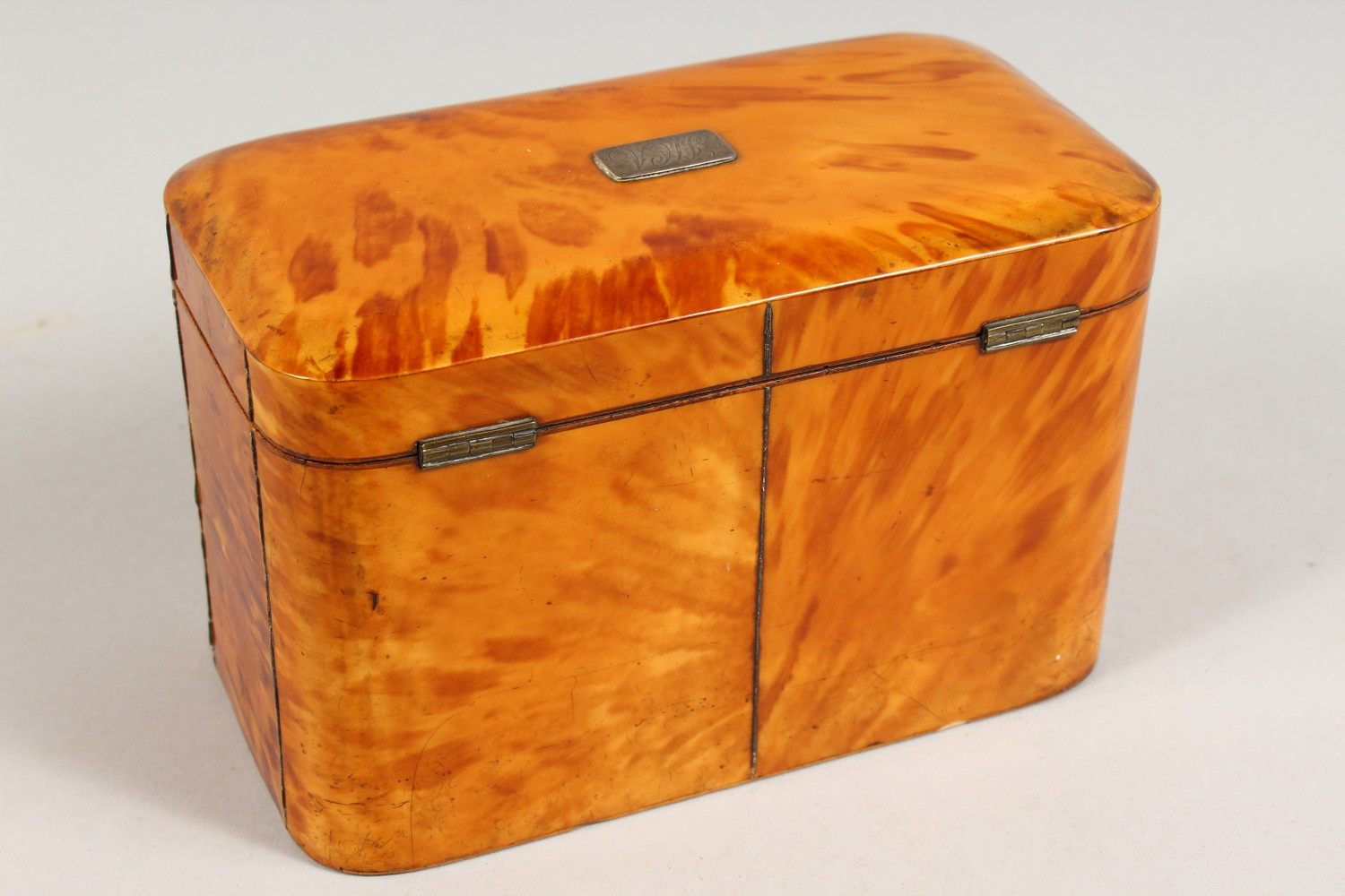 Lot 1431 - A GOOD GEORGE III BLONDE TORTOISESHELL TWIN COMPARTMENT TEA CADDY, with engraved silver plaque. 7ins