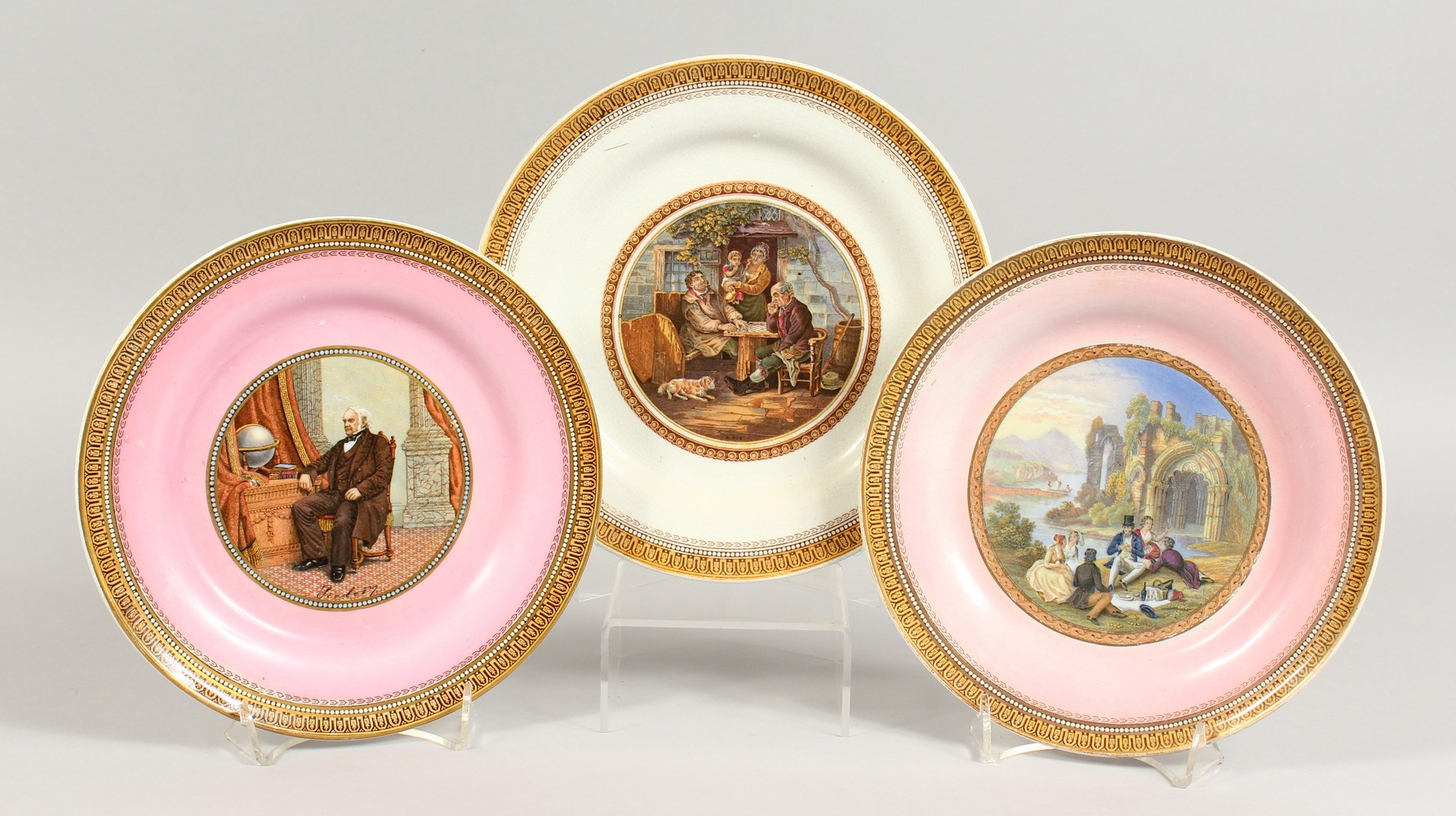 Lot 1097 - THREE VARIOUS PLATES, Picnic, Game of Draughts and Portrait. 8.25ins diameter.