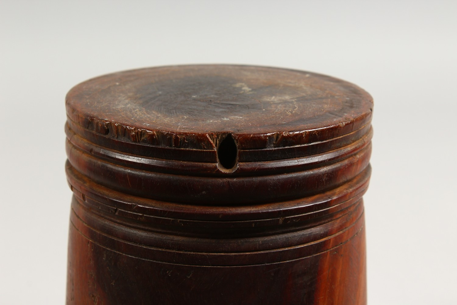 Lot 1510 - AN 18TH/19TH CENTURY LIGNUM VITAE MORTAR, with later pestle. Mortar: 7.5ins high.