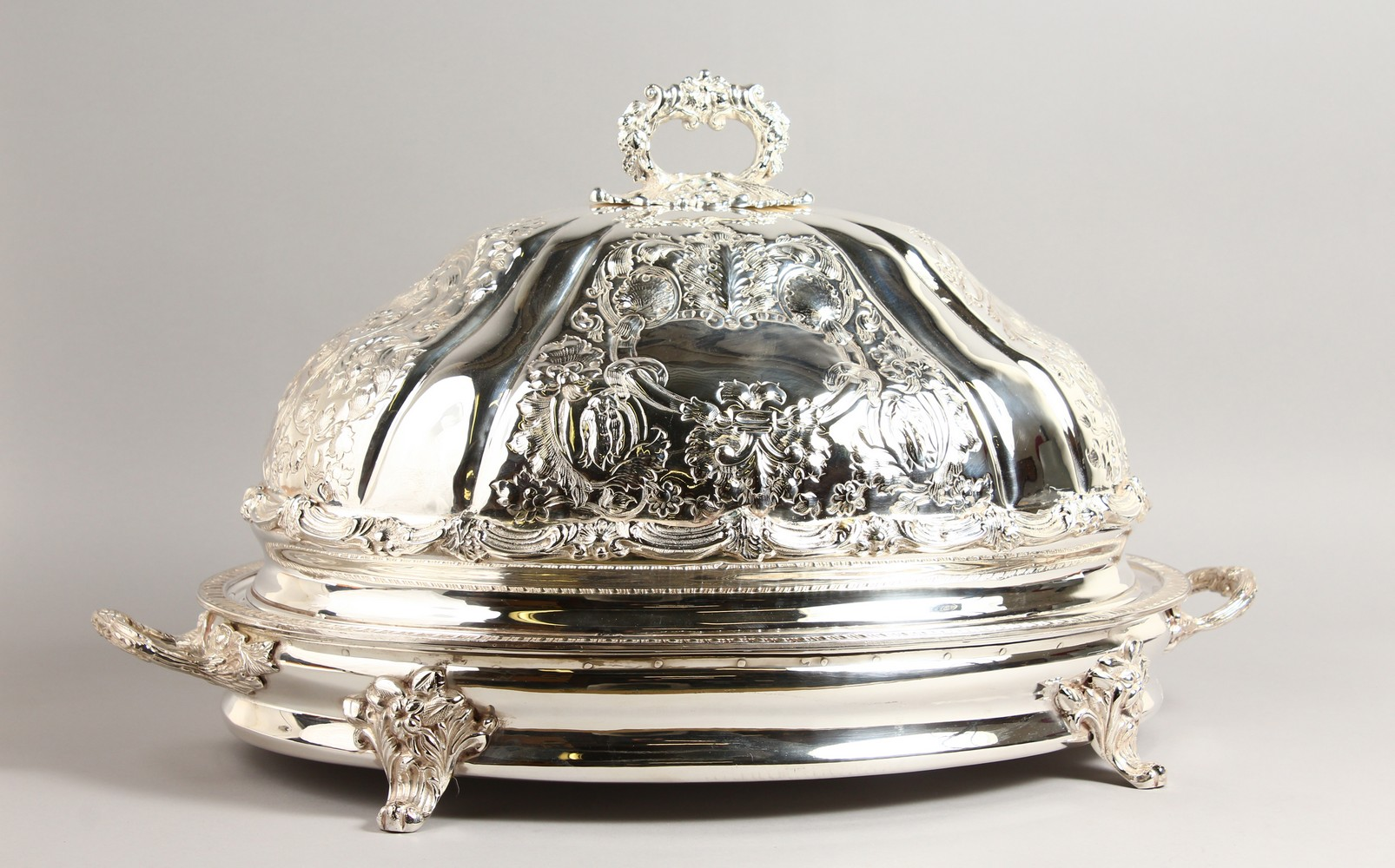 Lot 2058 - AN IMPRESSIVE LARGE VICTORIAN STYLE EMBOSSED MEAT DOME ON STAND. 26ins wide.