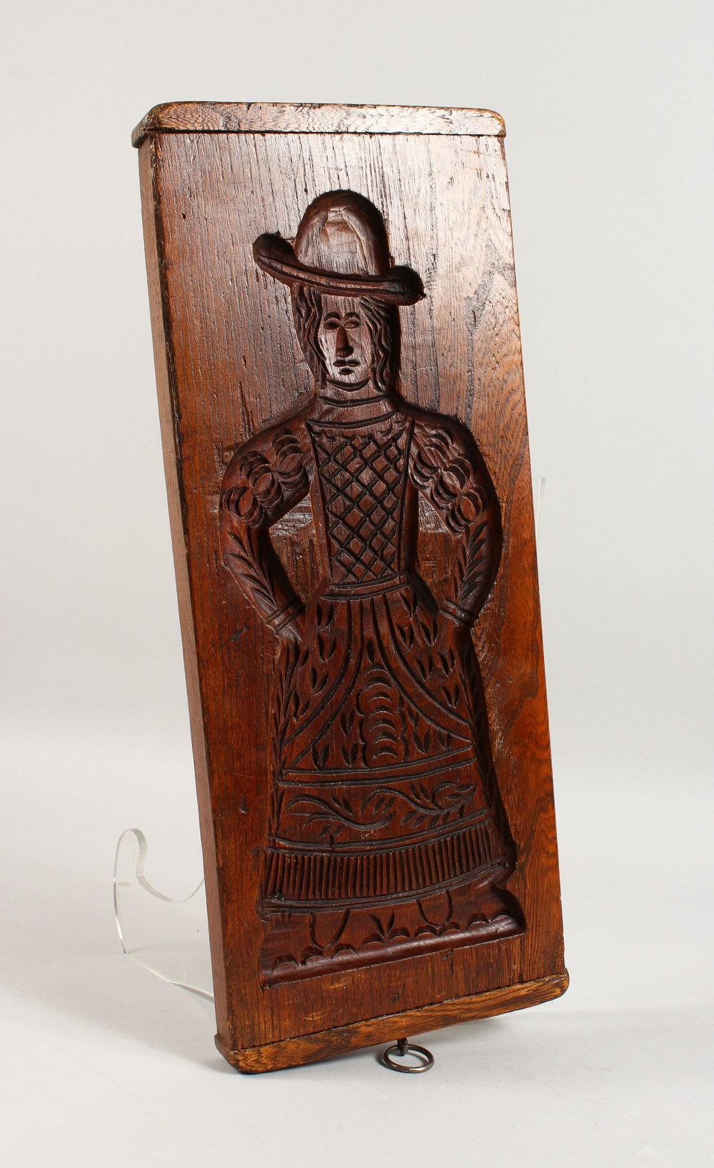 Lot 1551 - A 19TH CENTURY DOUBLE SIDED ELM GINGERBREAD MOULD, carved with a man and a woman. 18.5ins x 7.5ins.