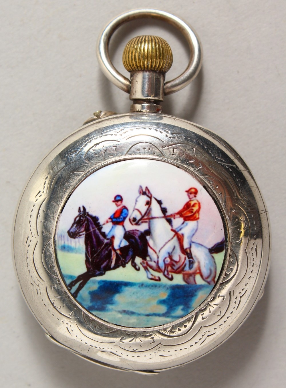 Lot 1863 - A SILVER FOUR DIAL POCKET WATCH, the back with an enamel of a steeplechase.