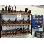 Two wall mounted racks of approx 42 machine tool collect chucks, as lotted