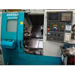 A Doosan S310NM CNC turning centre Serial number LSC1005 with Fanuc Series 21i-TB control, swarf