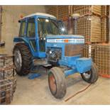 "FORD 7700 DIESEL TRACTOR WITH 4.2L 4 CYLINDER ENGINE, 60"" REAR TIRES, ENCLOSED CAB, RADIO, CLIMATE"