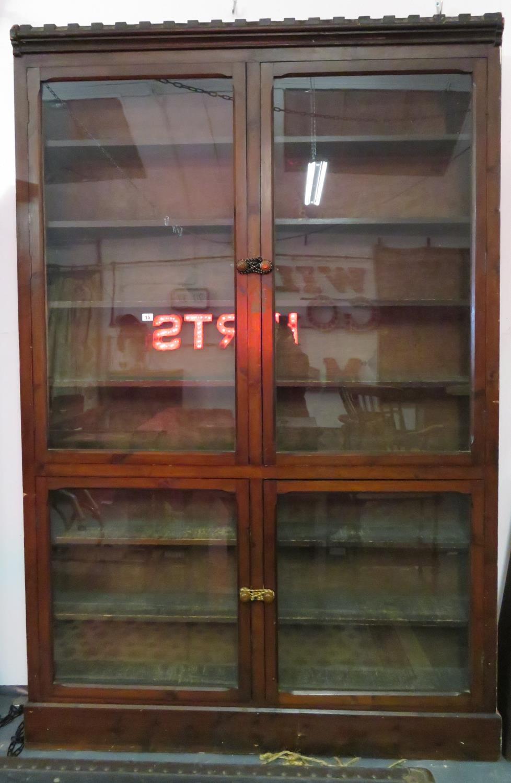 Lot 15 - 6' x 8' glass fronted bookshelf