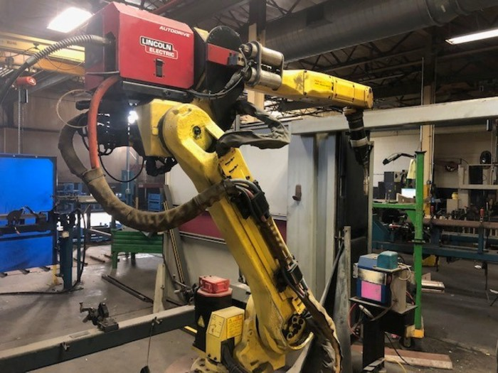 Lot 12 - FANUC ARCMATE 120IC/10L GENESIS 2G DUAL TRUNNION MIG WELDING CELL, YEAR 2011