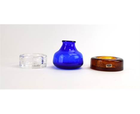 Erik Hoglund for Kosta Boda, a small blue glass vase, h. 8 cm, together with a Boda amber glass ashtray and a clear fish asht