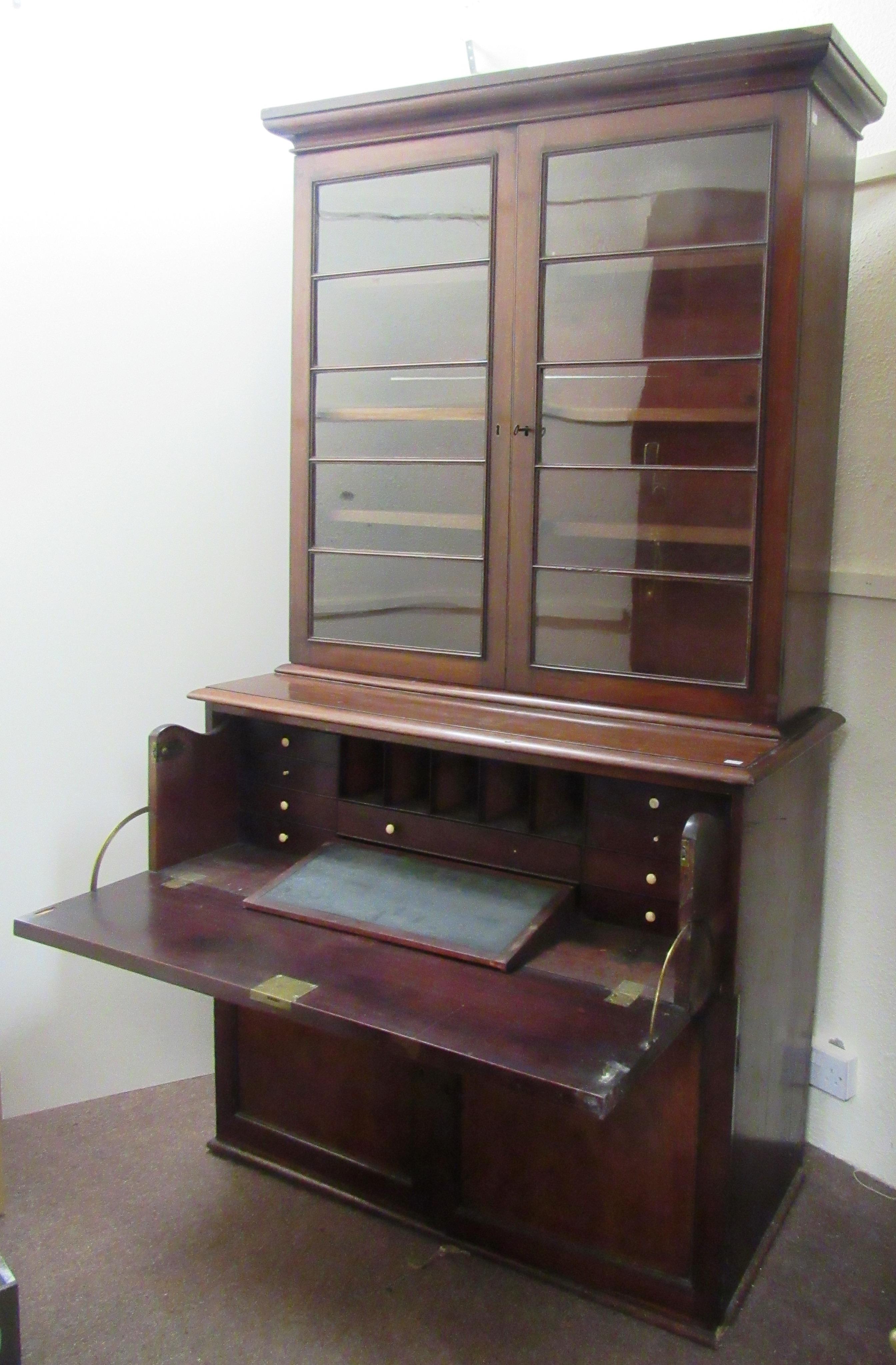 Lot 609 - Flann O'Brien's Bookcase / Desk A large William IV period Irish mahogany Secretaire Bookcase,