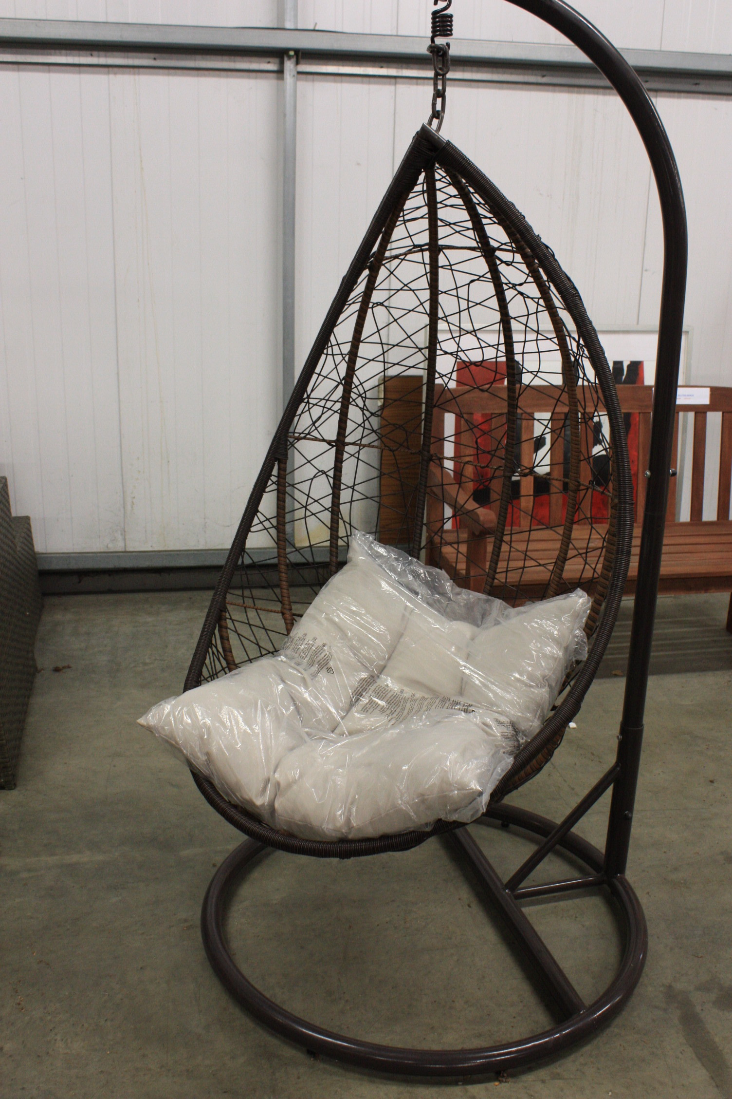 No Reserve teardrop swing chair on stand ex display