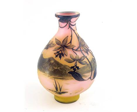 Emile Galle, a cameo glass landscape vase, circa 1905, purple over yellow and pink, flattened baluster form, decorated with o