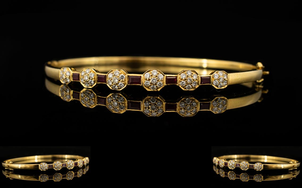 Lot 29B - An 18ct Gold Diamond And Ruby Set Bangle