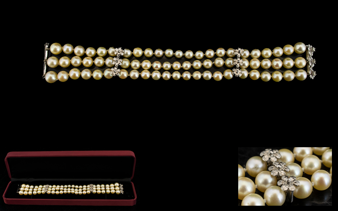 Lot 73 - A Triple Strand Pearl Bracelet Comprisin