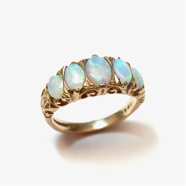 9 ct yellow gold five stone opal ring. - Image 1