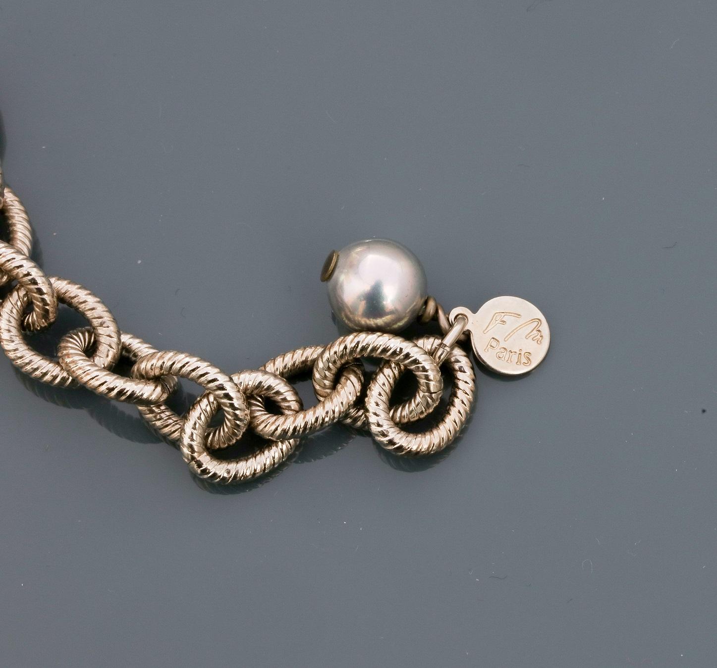 Françoise MONTAGUE, Collier formé d'une chaîne plate en métal rhodié portant [...] - Image 2 of 2
