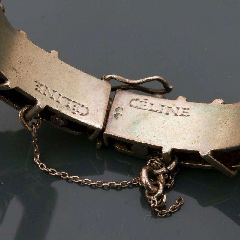 Lot 30 - CELINE, Bracelet en, argent 925 MM, signé, à décor de brides et mors [...]