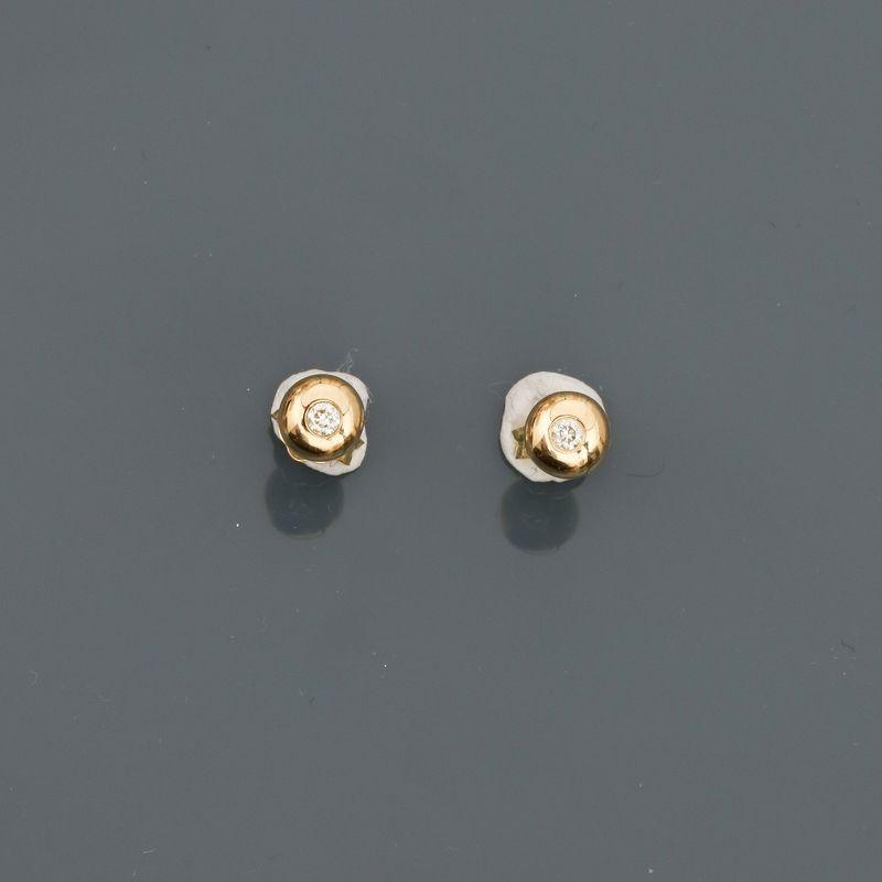 Puces d'oreilles en or jaune, 750 MM, ornée chacune d'un diamant, total : 0,10 [...]