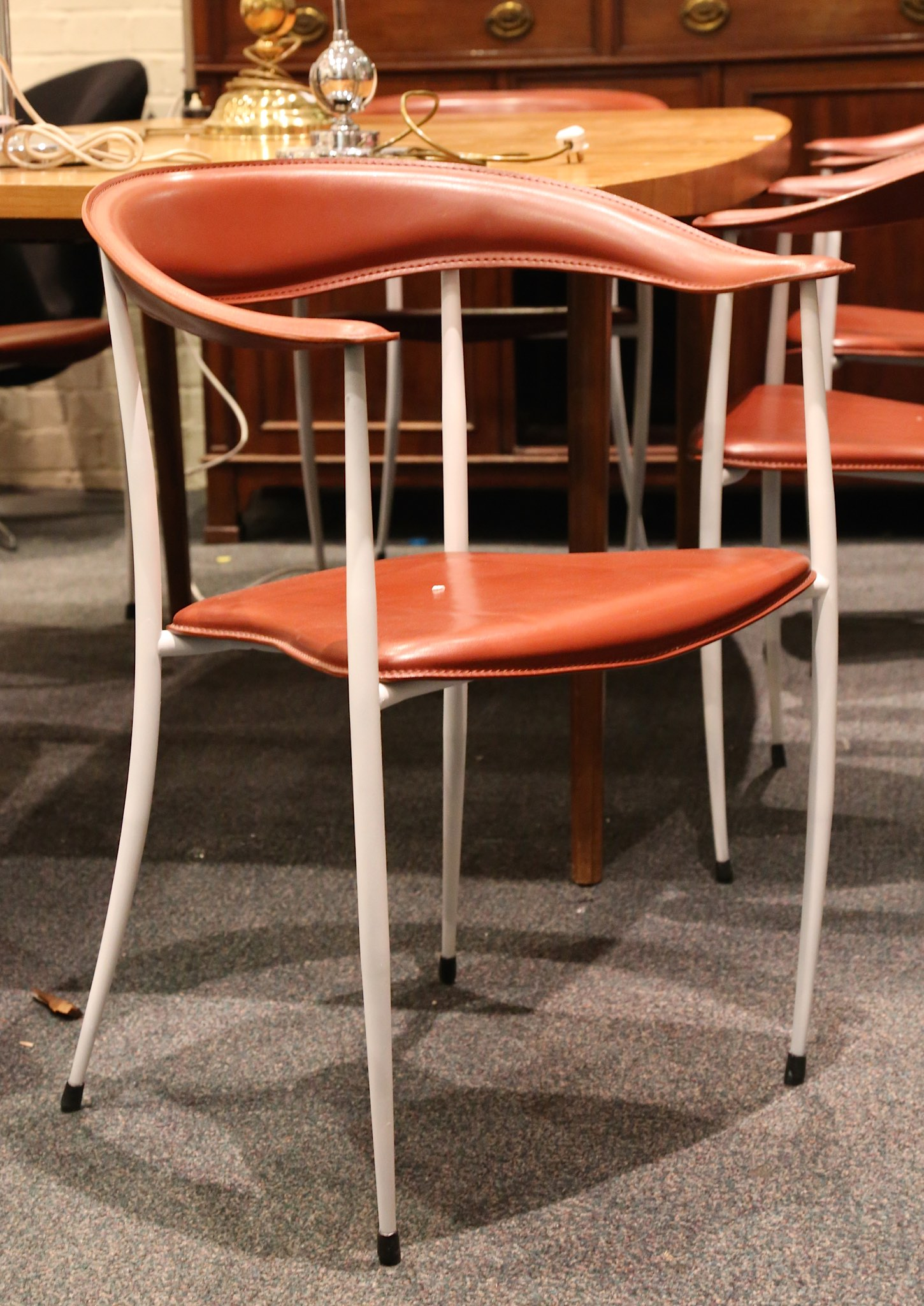 A SET OF SIX ARPER DINING CHAIRS tan leather seat and back rest