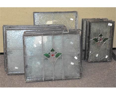Ten panels of leaded early 20th century stained glass