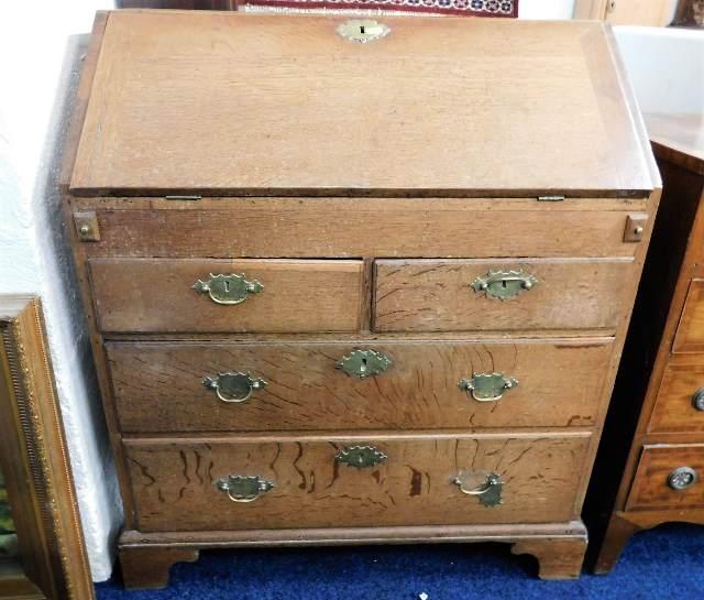 Lot 1 - An 18thC. oak bureau with brass fittings 32 in wid
