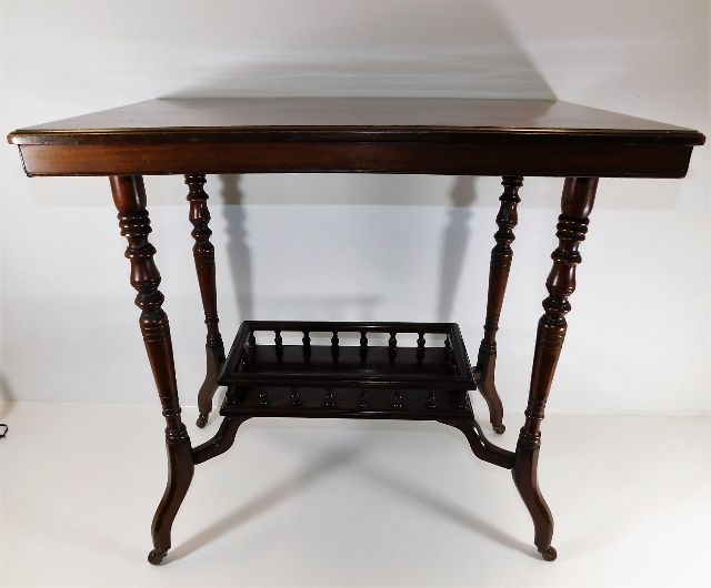 Lot 30 - A 20thC. mahogany table with gallery under