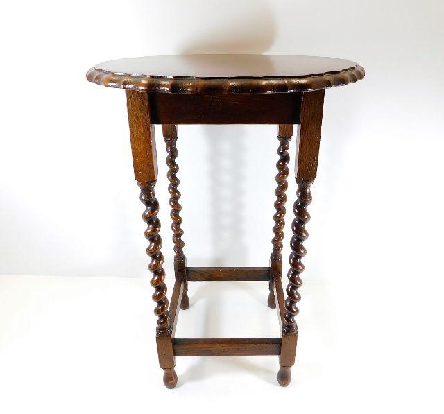 Lot 29 - An oak barley twist occasional table