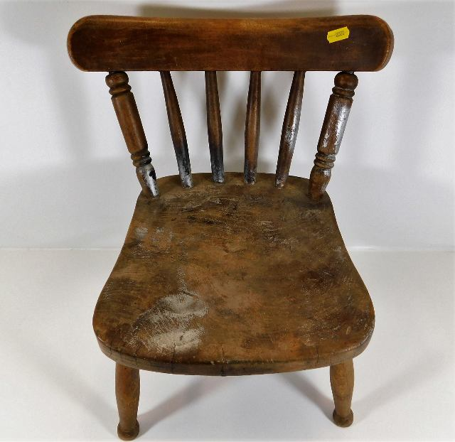 Lot 26 - A small 19thC. elm childs chair