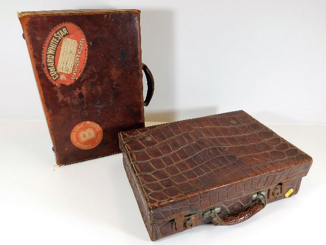 Lot 100 - A compact crocodile leather suitcase twinned with