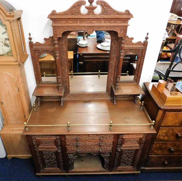 Lot 12 - An unusual c.1900 heavily carved dresser with Chin