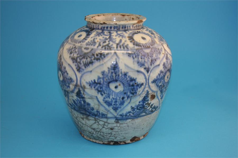 Lot 7 - An 18th/19th century Islamic tinglazed earthenware blue and white globular shaped vase decorated