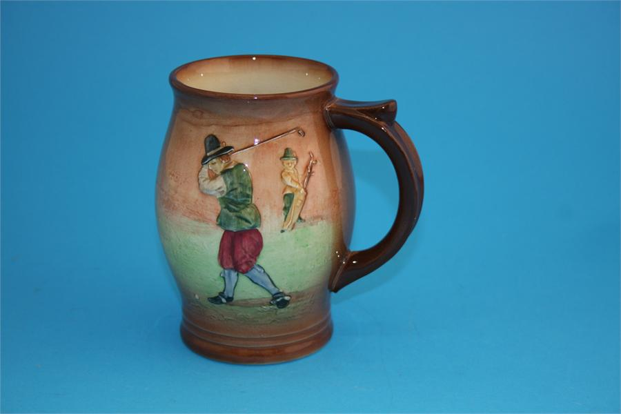 """Lot 19 - A Royal Doulton Seriesware  """"Golfing"""" pattern bulbous shaped tankard, decorated with a golfer"""