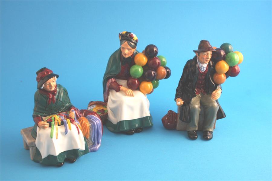 "Lot 18 - A Royal Doulton ""The Balloon Man"" HN1954, ""The Old Balloon Seller"" HN1315 and ""Silk and Ribbons"""