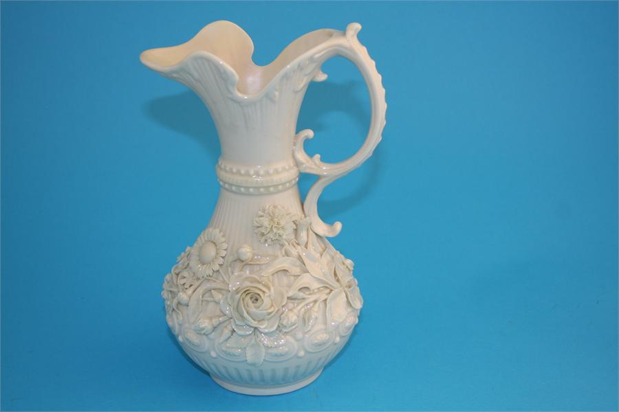 "Lot 31 - A large Belleek ""Aberdeen"" jug with applied flower decoration, printed second black mark.  23 cm"