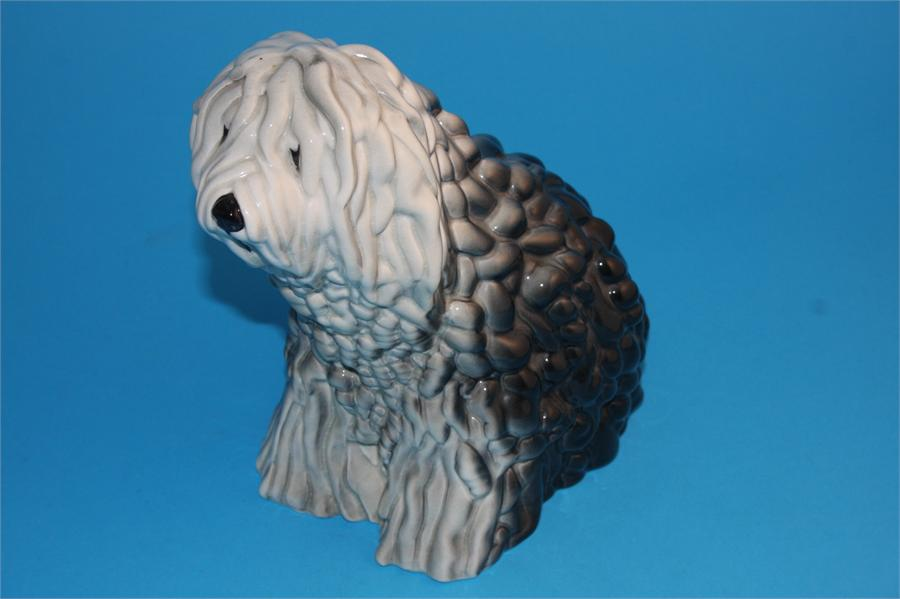 Lot 9 - A Beswick figure of a seated Old English Sheepdog, impressed number 453 and printed mark.