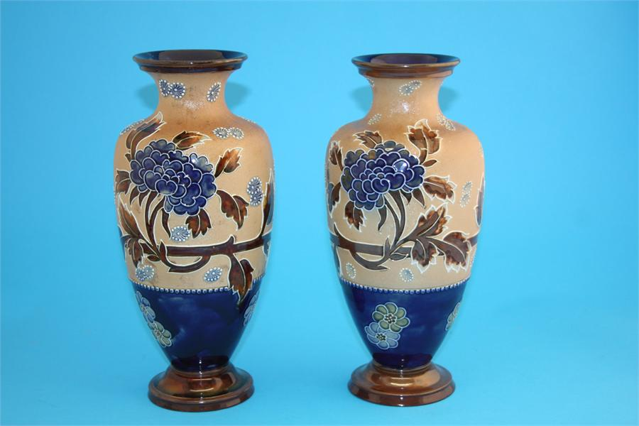 Lot 3 - A near pair of Royal Doulton Slaters patent vases decorated with autumnal leaves and chrysanthemums,