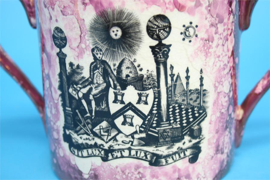 Lot 55 - A large Sunderland purple lustreware masonic two handled loving cup with verse to the reverse.  13