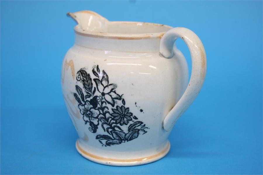 Lot 59 - A Sunderland orange lustre Ancient Order of Forrester's jug.  10 cm high
