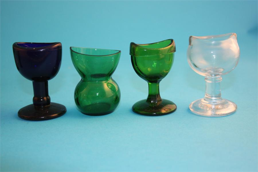 Lot 12 - A collection of glass eye baths, seven green, one blue and 3 clear glass. (11)