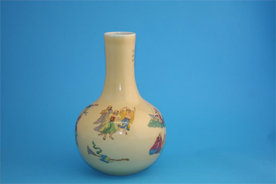 Lot 11 - A modern Chinese vase decorated with figures, of bottle shaped form.  32 cm high.