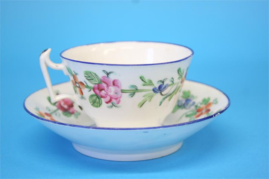 Lot 54 - Five tea bowls and saucers and a spare bowl, each decorated with a sprig of flowers, 4 cups and