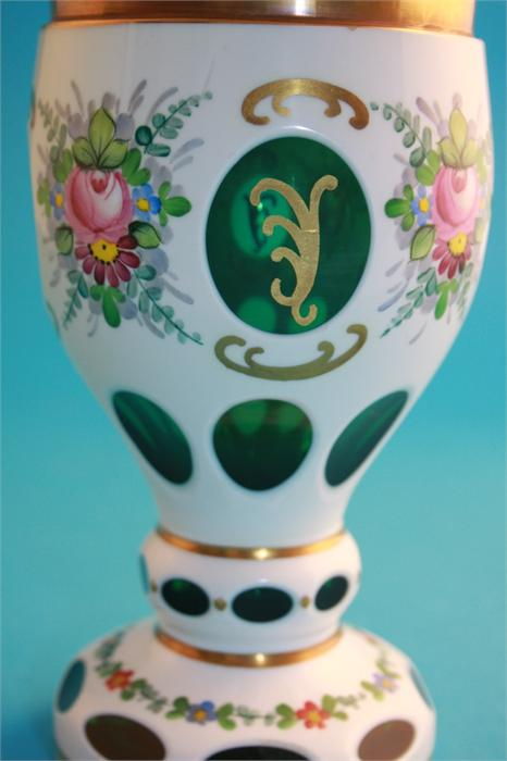 Lot 53 - A Victorian glass vase on pale pink ground decorated with enamelled flowers and a modern Bohemian