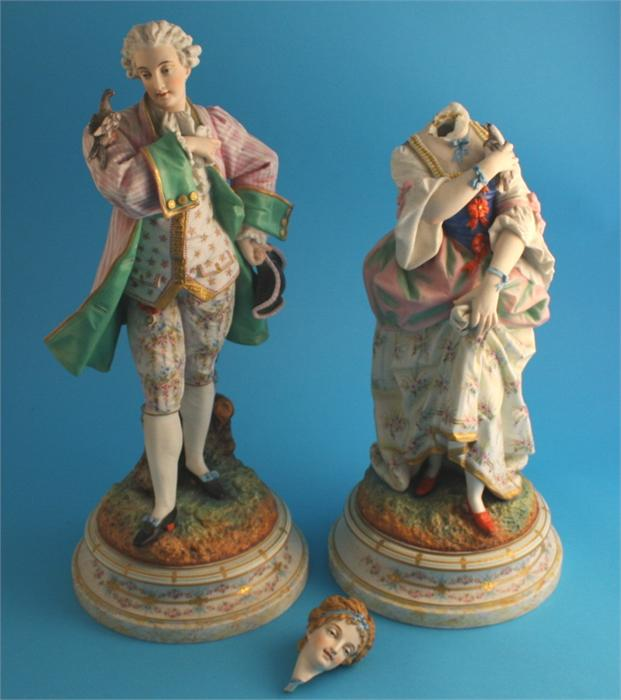 Lot 2 - A pair of continental bisque porcelain figures of a gallant and a lady; supported on stepped