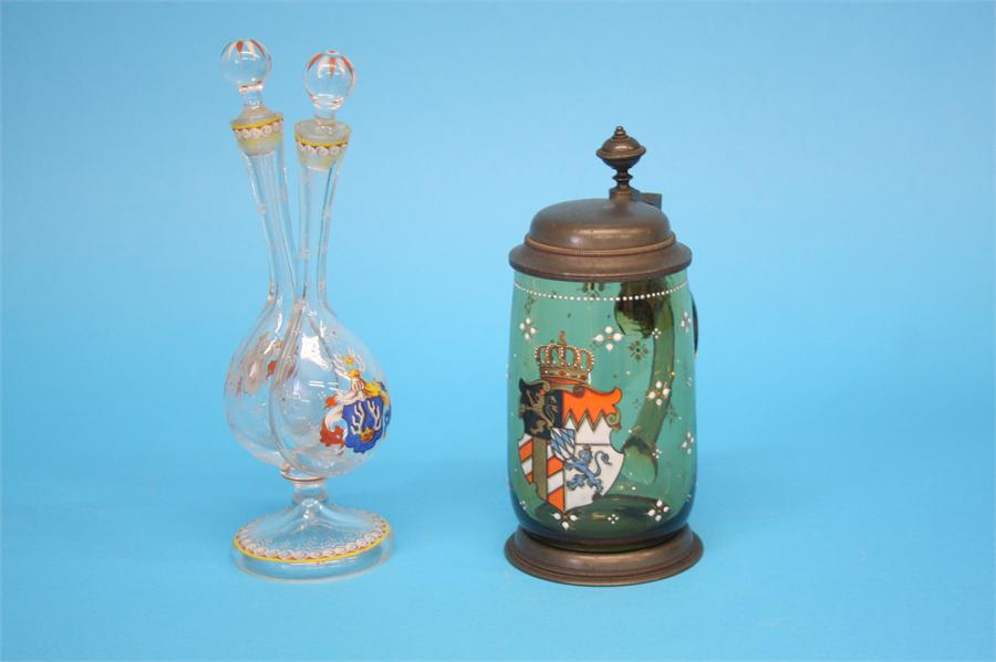 Lot 46 - A German clear glass double oil/vinegar dispensing bottle decorated with enamel armorials; and a