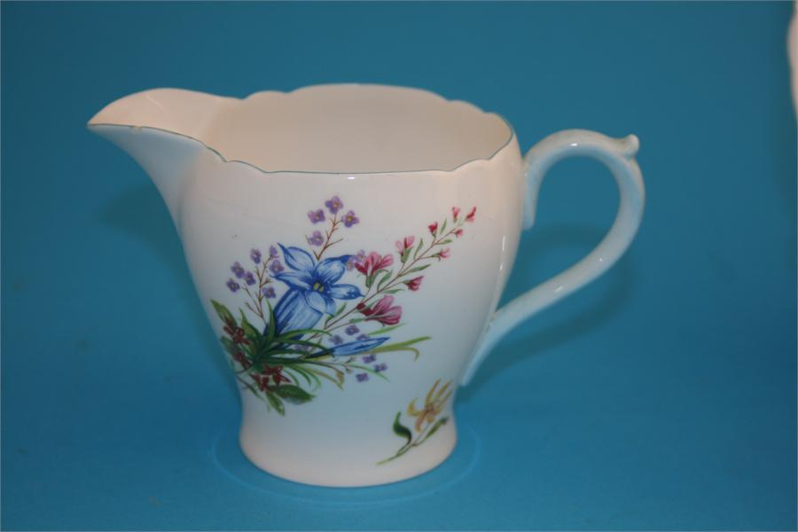 "Lot 15 - A Shelley ""Wild Flowers"" tea service comprising six cups, six saucers, six side plates, cake"