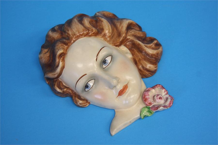 Lot 38 - A 1930's continental wall mask of a lady and another with a lady wearing a black hat.  21 cm long
